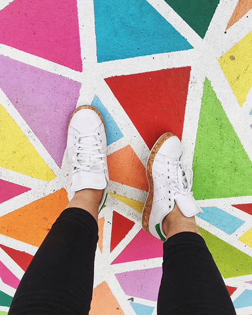 white shoes on bright mural